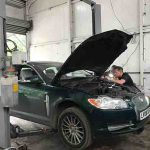 Jaguar with bonnet open being repaired by CCM garages