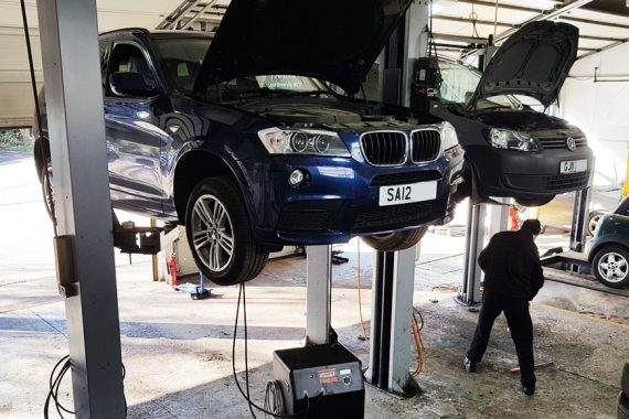 BMW and Volkswagen with bonnets open being repaired by CCM garages