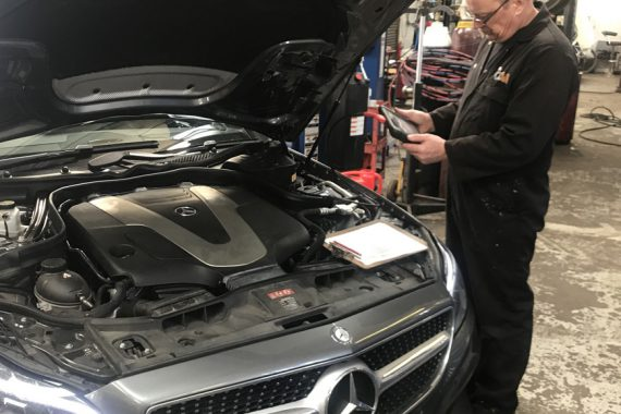Mercedes with bonnet open being repaired by CCM garages