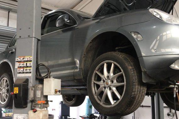 Porsche On Ramp With Bonnet Open at CCM Garage